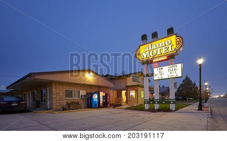 Sheridan, Usa - October 30, 2016: Motel Off I-90 At Night. The Name Motel First Appeared In 1926 (th