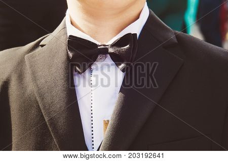 Baby Boy In A Tuxedo At The Ceremony.