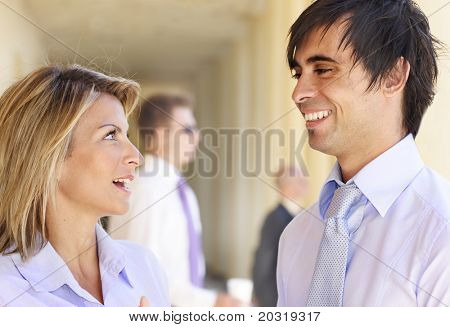 businessman and woman in happy conversation