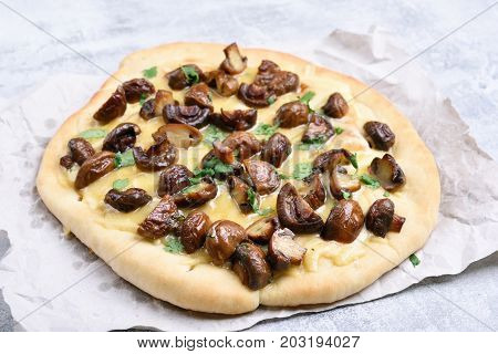 Pizza with mushrooms and cheese on light background close up