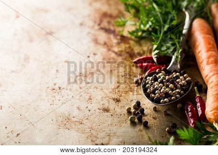 Tasty appetizing Food Ingredients Spices Old Metal Spoon on Yellow Background Side Composition Copy Space Cooking Healthy Food concept