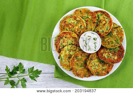 Delicious Zucchini Fritters On White Plate