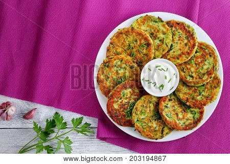 Yummy Zucchini Fritters With Sour Cream