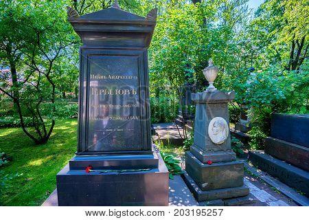 SAINT PETERSBURG, RUSSIA - JUNE, 2015: NECROPOLIS OF ALEXANDER NEVSKY LAVRA. MONUMENT TO RUSSIAN AUTHOR IVAN KRYLOV
