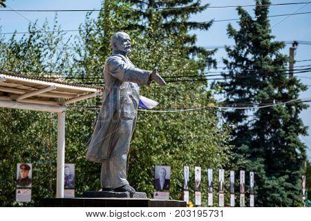 SINYAVSKOYE, RUSSIA - JUNE, 2017: MONUMENT OF RUSSIAN COMMUNIST VLADIMIR LENIN ON SUNNY DAY