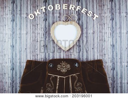 Oktoberfest beer festival background on wooden table. Flat lay style.