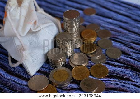 Golden coin and old coin stacking or golden coin and old coin image use for business concept or financial concept background