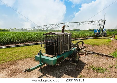 Water pump with diesel engine soybean field crop irrigation using the center pivot sprinkler system.