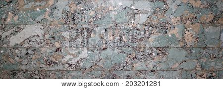 Abstract textured background of multicolored marble slabs
