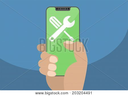 Wrench and screwdriver icon on modern bezel-free / frameless smartphone touchscreen.Hand holding smartphone as concept for fix, maintenance, repair or IT support.