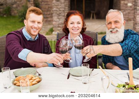 Family Clinking Glasses Of Wine