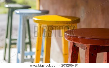 Colorful stools in front of counter bar in coffee shop and blur background with shallow depth of field.