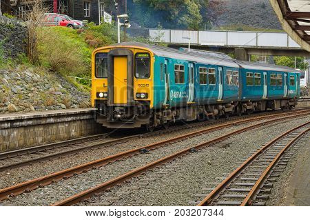 Blaenau Ffestiniog Wales UK - September 4 2017: Arriva Trains Wales passenger train Sprinter Class 150/2 diesel multiple unit or DMU departing the station at Blaenau Ffestiniog in Wales