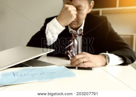 Businessman feel sad Disappointed when recived white envelope resignation