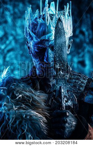 Halloween. The King zombie warrior in the armor of a medieval knight covered with snow. Horror fantasy film.