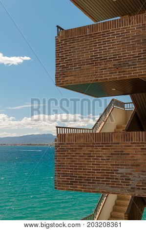 Brick staircase on the background of the sea and mountains. Architectural composition. Architectural abstraction.