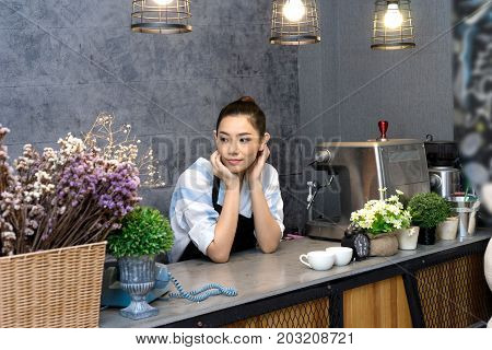 Asian Woman Standing In Counter Of Coffee Shop Barista