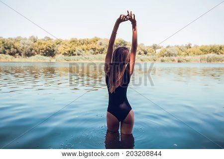 Outdoor portrait beautiful girl in swimwear posing