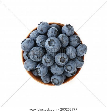 Blueberries In Wooden Bowl Close Up Over White