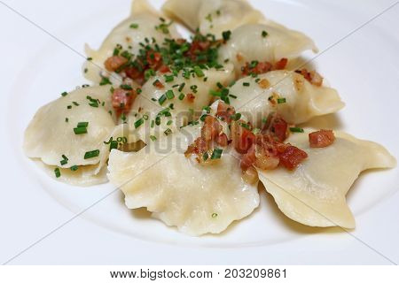 Dumplings With Bacon And Green Chives Close Up