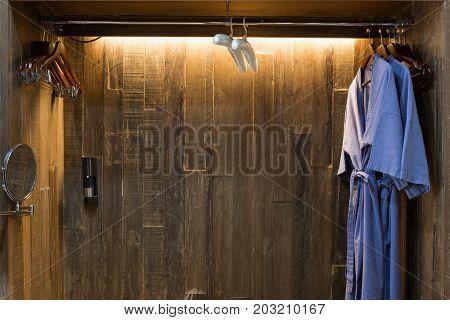 Blue Twin Bathrobe In Wooden Wardrobe Of Luxury Hotel