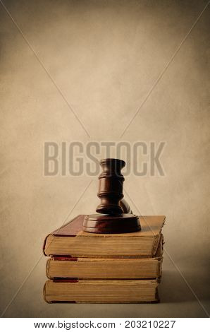 Pile Of Old Books Topped With Gavel