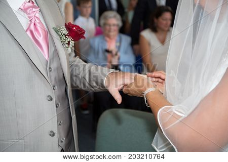 Bride Put The Wedding Ring On Her Groom