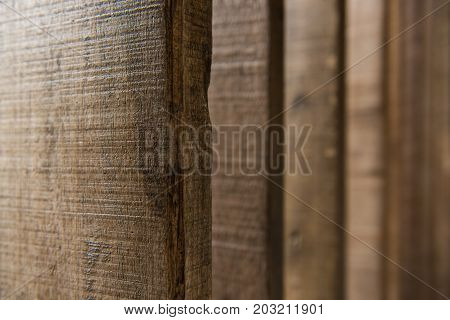 Dark Colored Wood Fence Texture Background, Abstract Vertical Line (selective Focus)
