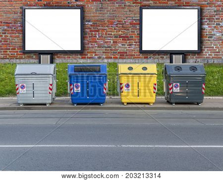 Several recycling container and two billboard close
