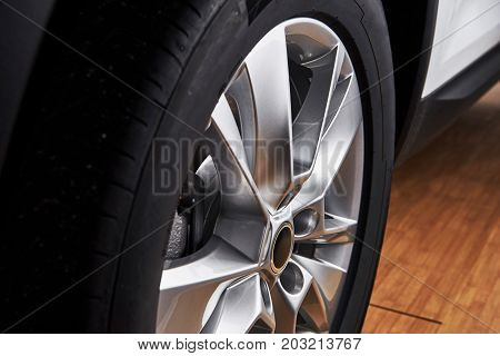 Part of modern new wheel car with disk brake pad.