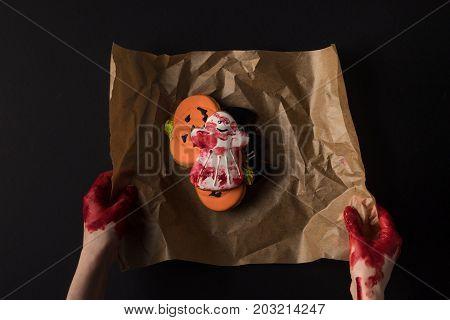 Hands Wrapping Halloween Cookies