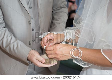 Marry Me Today And Everyday, Hands Of A Wedding Heterosexual Couple. Groom Put A Ring On Finger Of H