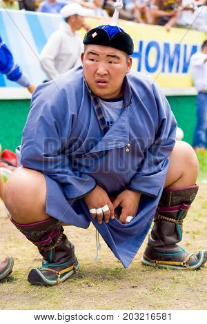 Naadam Festival Heavyweight Wrestler Squatting
