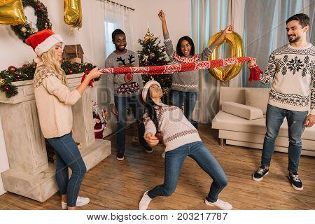 Multiethnic Friends Playing Limbo Game