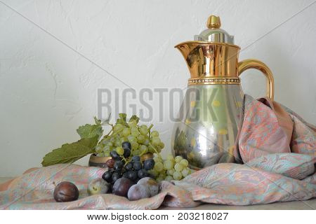 still life with grapes and a Golden pitcher in Eastern style