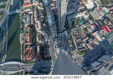High modern building and office area in big city, top view at sunny day in Tianjin, China