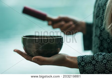 Tibetan Bowl,  One Woman Only, Toned Image, Outdoors By The Lake,