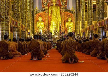 CHIANG MAI THAILAND - 1/18/2016: Monks praying at Wat Chedi Luang temple in Chiang Mai Thailand.