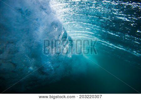 Blue tropical ocean in underwater. Wave underwater.