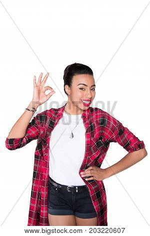 stylish african american woman showing okay sign isolated on white