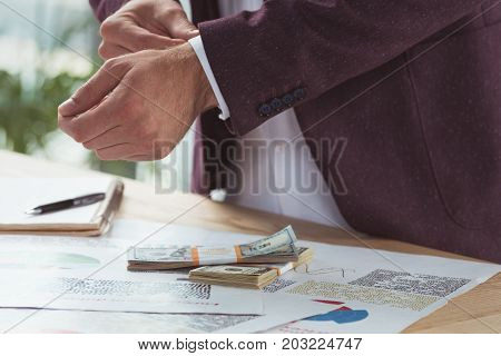 Businessman With Paperwork And Money