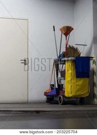 Cleaning tools cart wait for cleaning.Bucket and set of cleaning equipment in the office.
