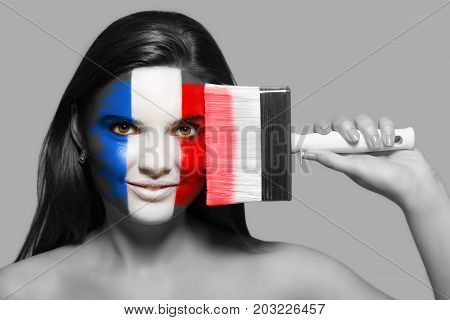 Female supporter in national colors of France