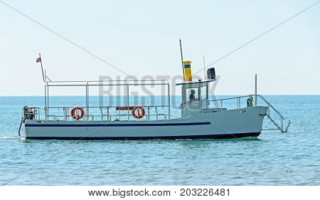 Boat Or Ship Navigating On Blue Black Sea Water, Entertaiment Yacht