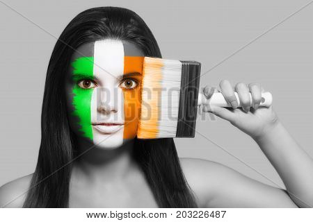 Female supporter in national colors of Ireland