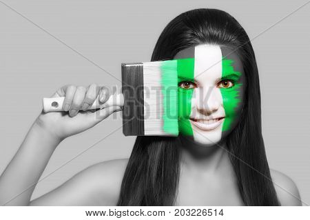 Female supporter in national colors of Nigeria