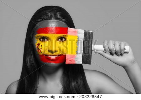 Female supporter in national colors of Spain