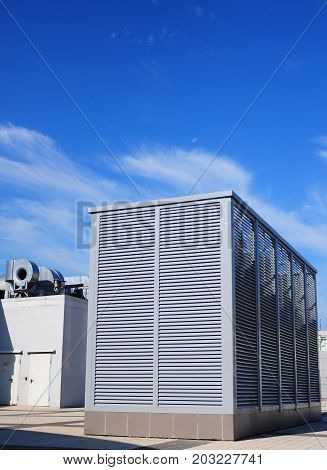 Industrial air conditioning and ventilation systems on the street against clody sky. Ventilation system of factory.