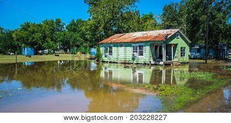 Old Poor Home relfection Flooded after Hurricane Harvey destroyed the town of Columbus , Texas southwest of Houston , Texas a Small Town Disaster easily overlooked wide angle view