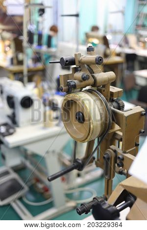 MOSCOW - FEB 21, 2017: Sewing machine in Ralf Ringer shoes factory. In 1995 Ralf Ringer started manufacturing its own shoes